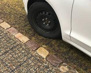 stone-filled-driveway-white-car-wheel
